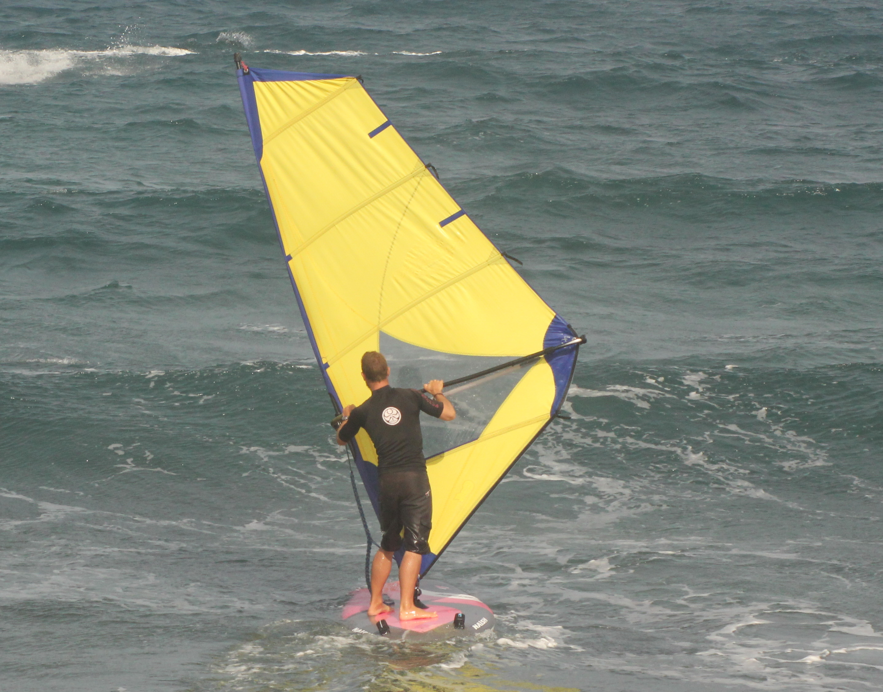 How to Stop a Windsurfer - Press sail against the wind
